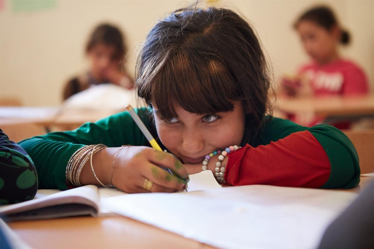 A Syrian girl takes part in basic numeracy and literacy lessons at the Back to the Future centre in Akkar.